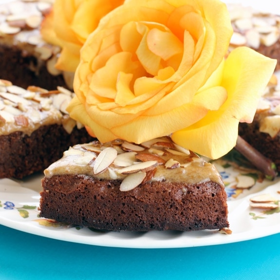 gluten free chocolate cake with yellow roses on top