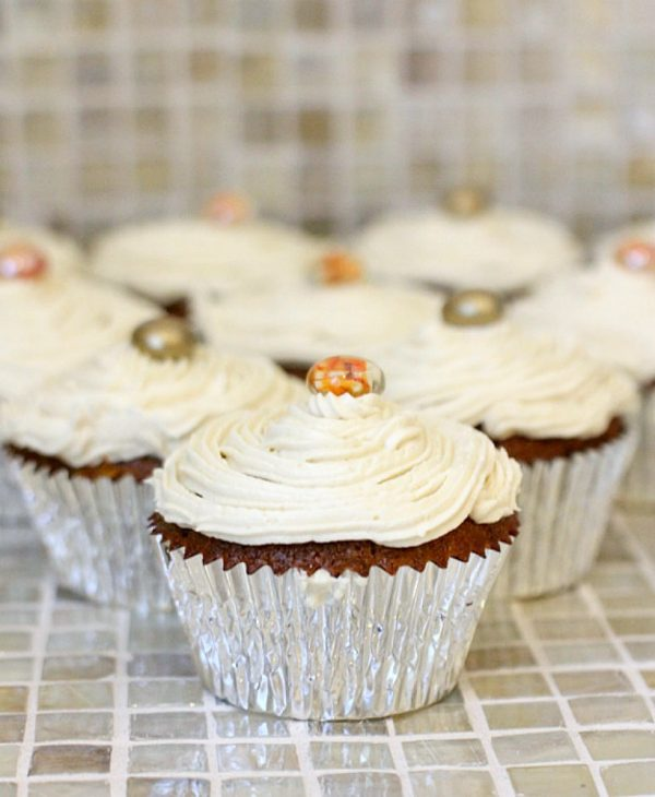 Gluten free pumpkin muffins, 2 ways! Choose if you want a healthy{ish} version OR an indulgent version, topped with maple buttercream frosting. Either way you choose, they're absolutely delicious!