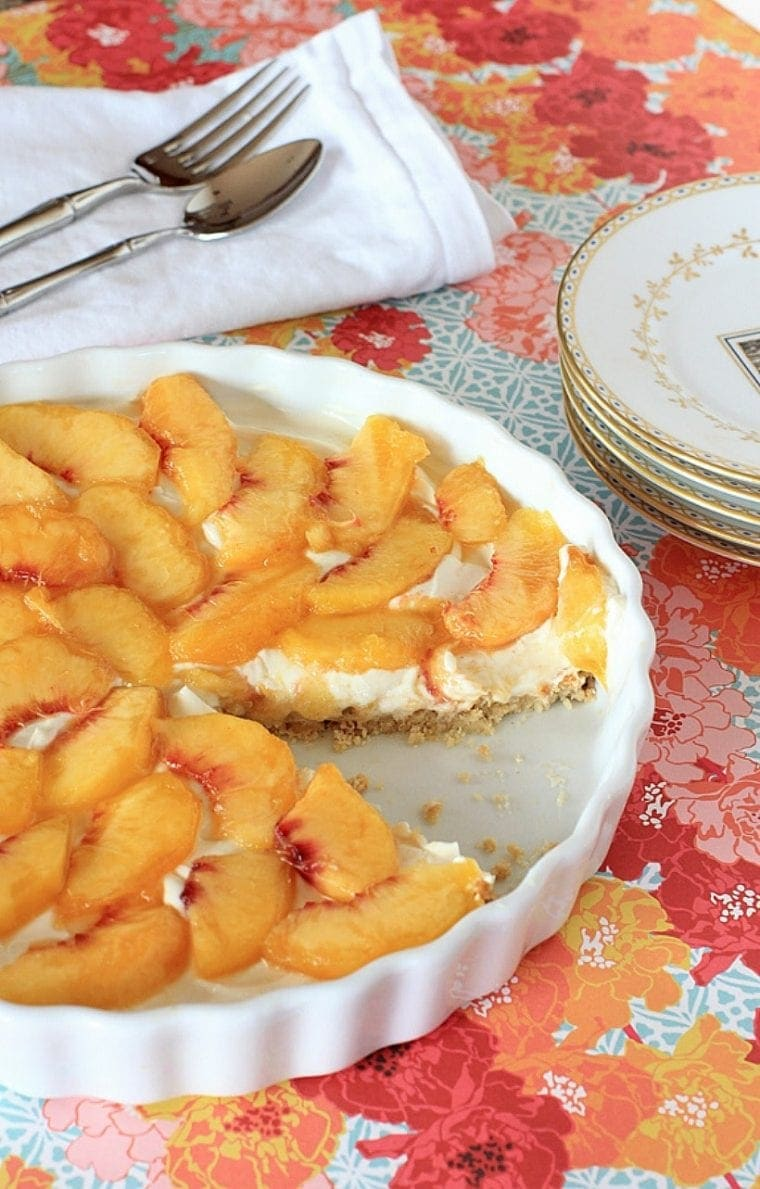 Peaches and Cream...Oh, What a Dream! Gluten Free Peach Tart w/ Cream Cheese, Berry Sauce, & Cinnamon Almond Crust | Recipe @thespicyrd