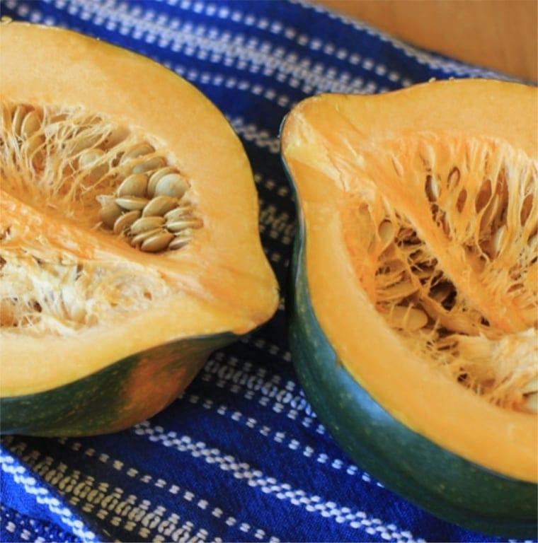acorn squash halves on a blue kitchen towel