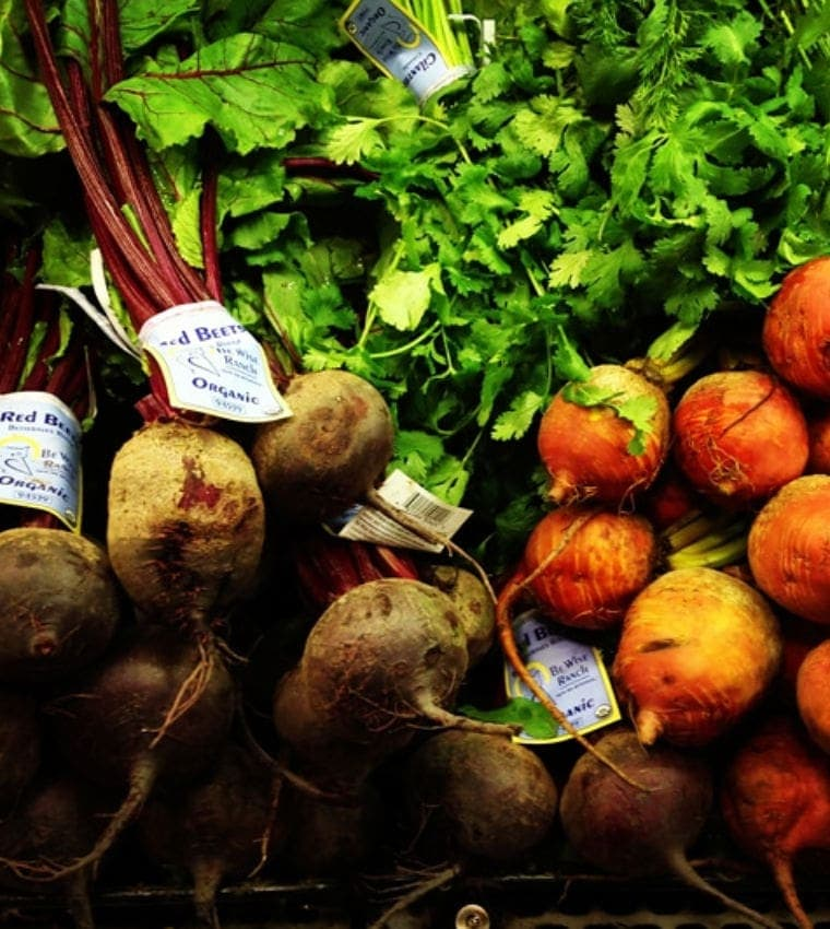 bunches of fresh beets with beet greens