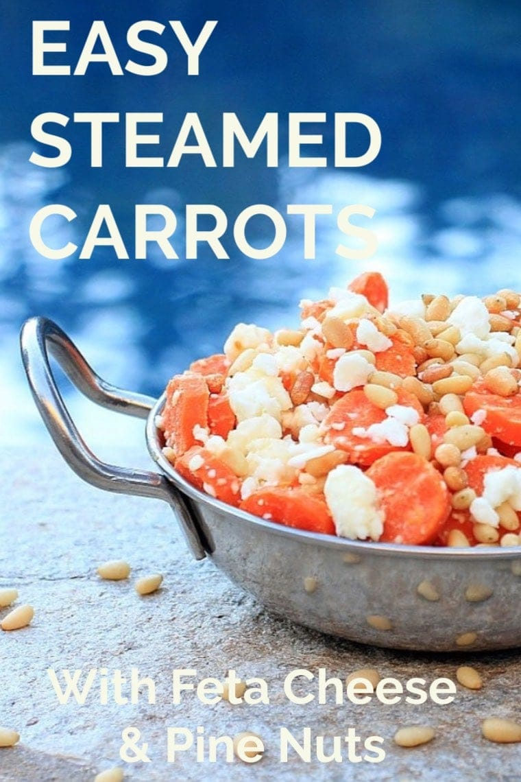 Easy Steamed Carrots with pine nuts and feta cheese in a serving dish.