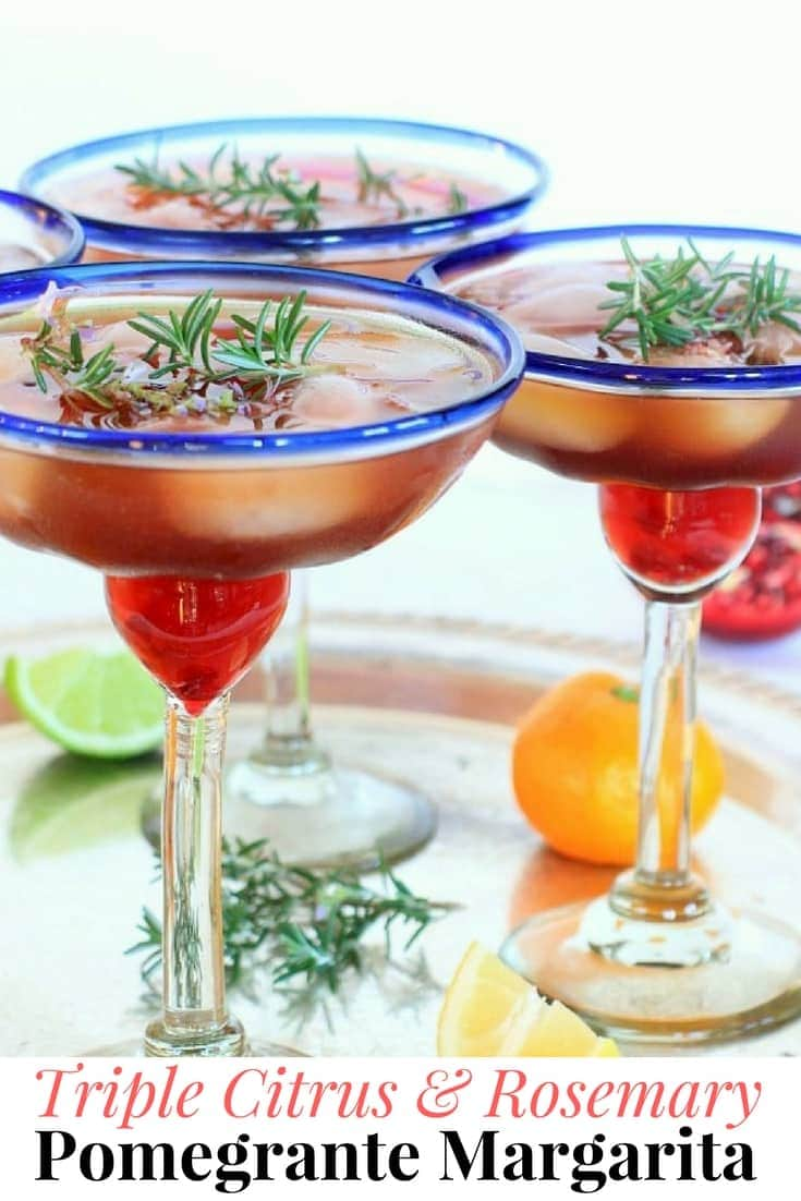 This pomegranate margarita is a seasonal twist on the traditional margarita. In-season citrus fruits + rosemary simple syrup add delicious holiday cheer! Swap the tequila w/ sparkling water, for an equally festive mocktail. Recipe at EA Stewart @thspicyrd #cocktails #holidayrecipes #margarita #newyearseve #christmas