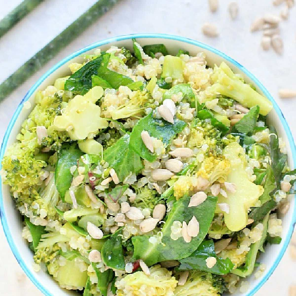 Bowl of miso broccoli quinoa salad with greens.