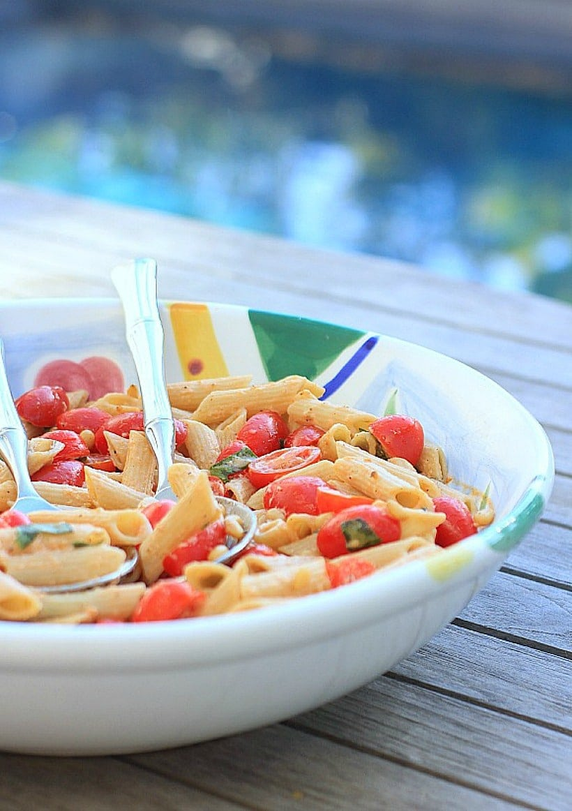 This gluten free pasta salad with sweet grape tomatoes, peppery basil, and fresh ricotta cheese is a delicious solution when you need a quick and easy weeknight dinner everyone will love!