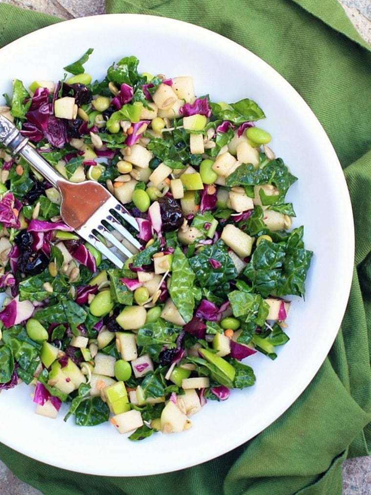 Kale power salad on a white plate