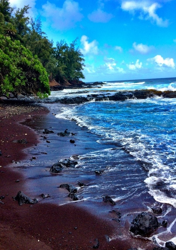 One of the most gorgeous beaches ever-Red Sand Beach in Hana on the island of Maui, Hawaii.