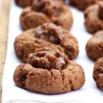 #AD Moist, chewy, and delicately spiced, these naturally sweetened Gluten-Free Gingerbread Cookies are taken to a whole other level with Sea Salt Caramel Rum Raisin Caramel Filling. P.S. They're vegan too!