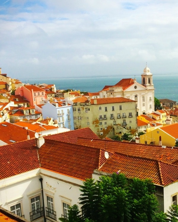 Lisbon, Portugal is a beautiful city with all the gorgeous colorful buildings and red tile roofs. | Spicy RD Nutrition
