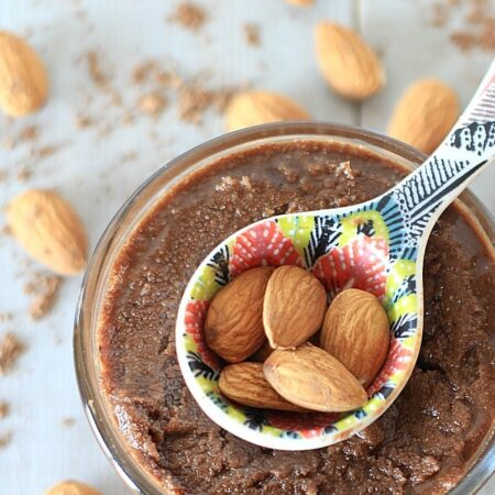 Low in sugar, and rich in nutrition and flavor, this 5 ingredient Mexican Chocolate Almond Butter is super easy to make & much more economical than store bought nut butters.