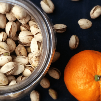 Simple snacking at it's best! Trader Joes Salt and Pepper Pistachio Nuts and a Tangerine!
