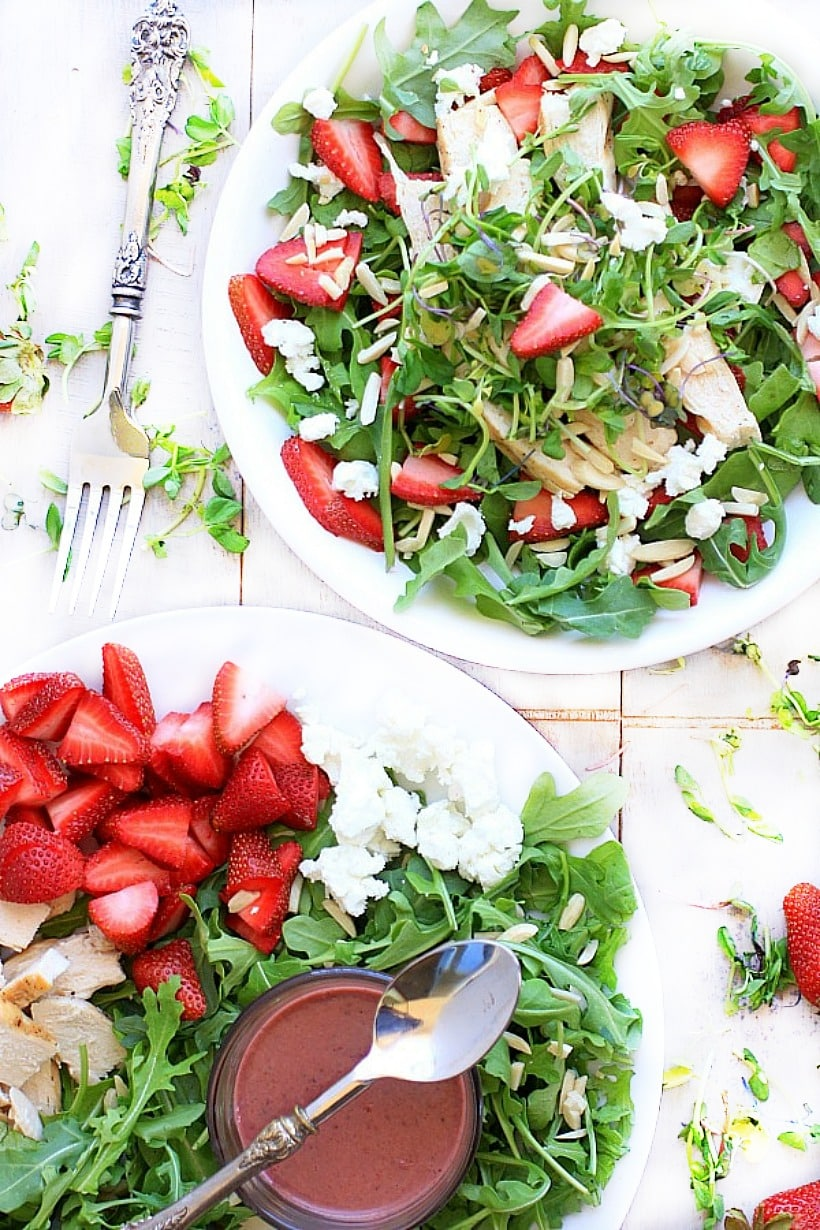 Strawberry Arugula Salad with Strawberry Salad Dressing on a white plate