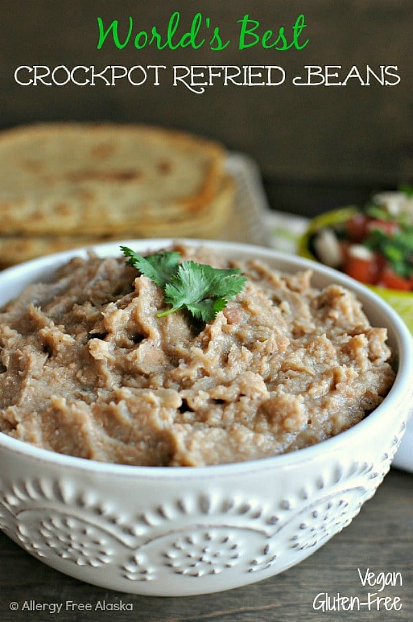 Crockpot Refried Beans in a white bowl.