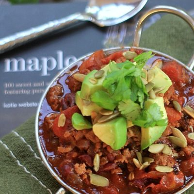 This Smoky & Sweet Turkey Chili topped with avocado, pumpkin seeds, and cilantro is a healthy and delicious addition to your chili recipe collection!