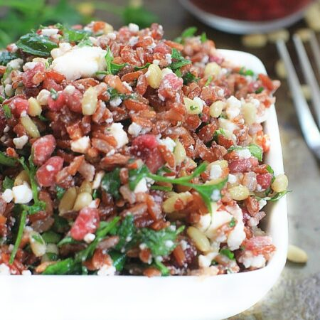 Fresh, fast, and delicious, this Red Jasmine Sprouted Rice Salad with Pomegranate, Feta, Pine Nuts, and Fresh Herbs, is a healthy side or main dish to enjoy over the holidays, and all year long!
