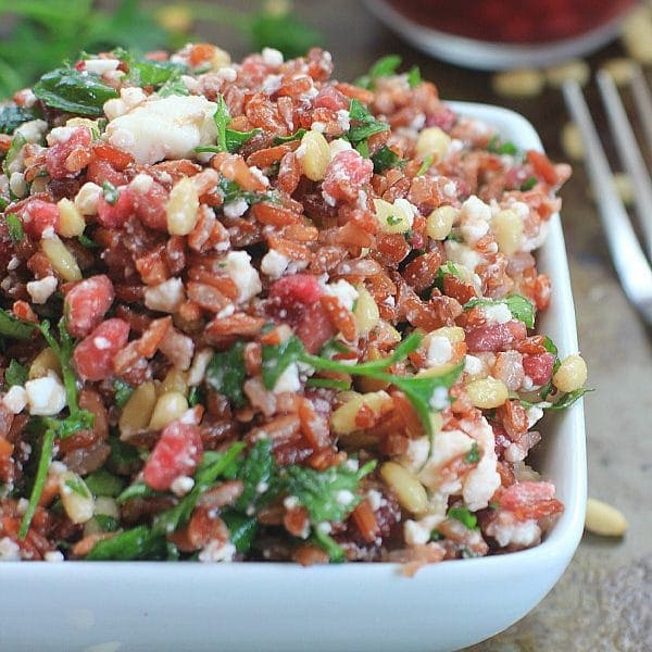 Fresh, fast, and delicious, this Red Jasmine Sprouted Rice Salad with Pomegranate, Feta, Pine Nuts, and Fresh Herbs is a healthy side or main dish to enjoy over the holidays, and all year long!