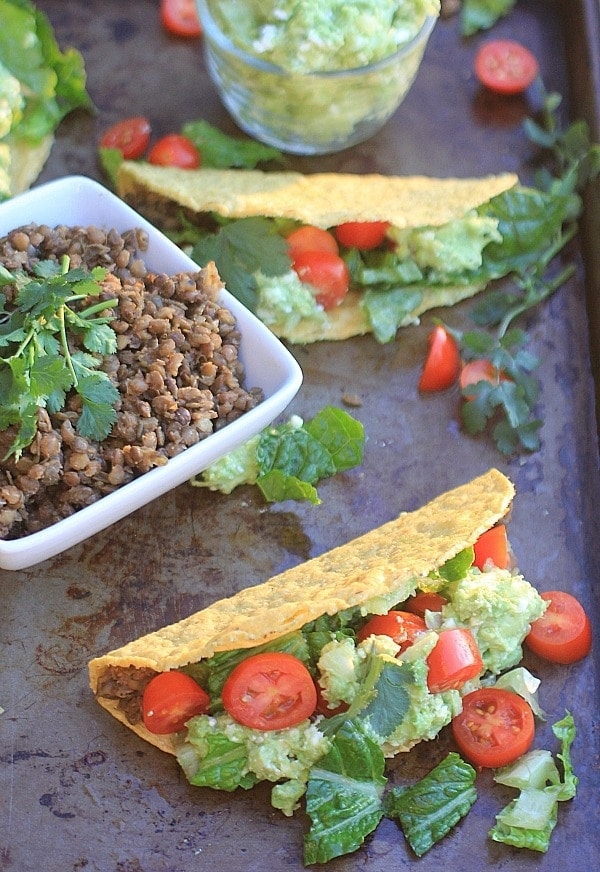 These Crunchy Lentil Tacos w/ Avocado Feta Guacamole are absolutely delicious & super healthy too-perfect for Meatless Monday! | Recipe is vegetarian & gluten free.