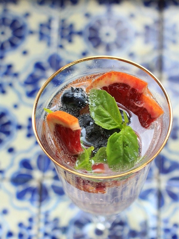 This Sparkling Water with Blueberries, Blood Oranges, and Basil is a delicious way to hydrate healthier! | Sponsored by Nestle Waters at The Spicy RD