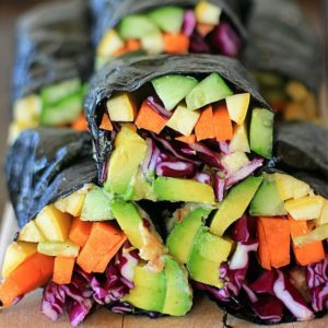vegetable nori wraps on a wooden cutting board