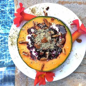 Cottage cheese, berries and nuts stuffed in 1/2 a cantaloupe