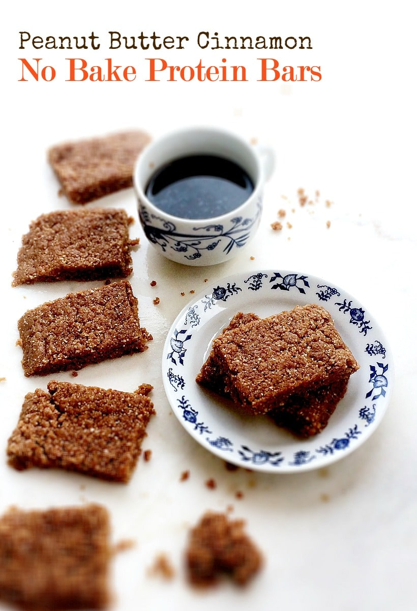 Peanut Butter Cinnamon No Bake Protein Bars on a blue and white dish with a cup of coffee.