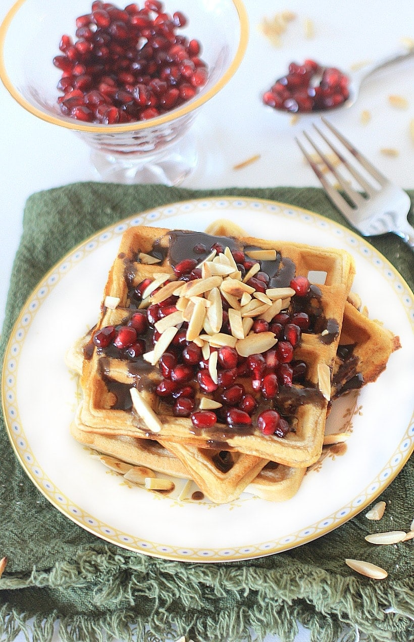 Dig in to these festive Cinnamon Toast Gluten Free Waffles w/ Pomegranate Orange Syrup and Toasted Almonds