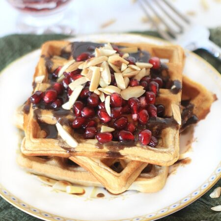 Gluten Free Waffles with Pomegranate Orange Syrup and Almonds