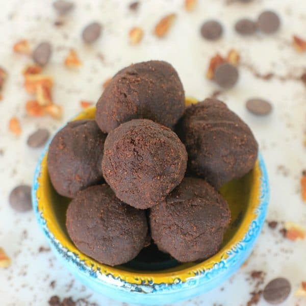 Happy Belly Brownie Bites! You'd never guess that these luscious, super chocolaty Brownie Bites are made with organic green banana flour, a resistant starch that helps promote a happy, healthy gut microbiome! | This no-bake recipe takes less than 5 minutes to make and is vegan, gluten free, and grain free