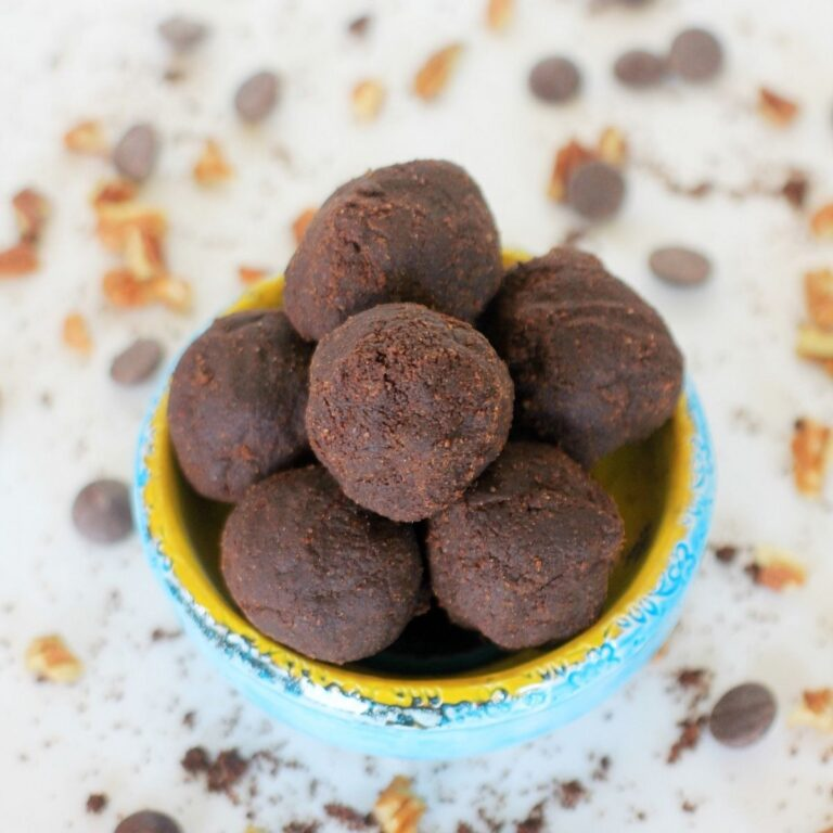 Blue and yellow ceramic bowl filled with chocolate banana flour brownie bites.