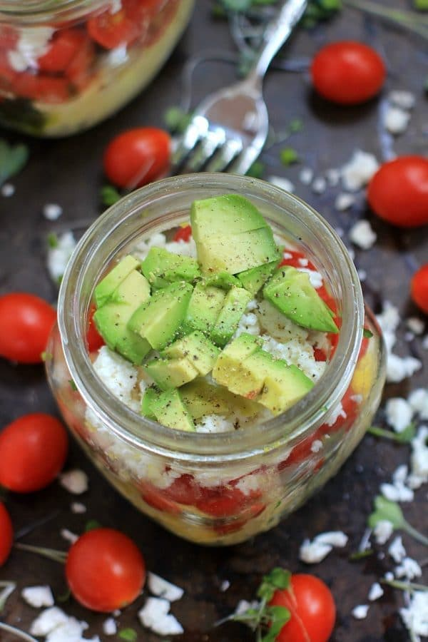 Genius Healthy Breakfast Hack! Scrambled Eggs in a Jar w/ Avocado, Pesto, Feta Cheese, and Sugar Plum Tomatoes | Recipe, at The Spicy RD, is gluten free, low carb, vegetarian, w/ a low FODMAP option. Delicious for lunch or dinner too!