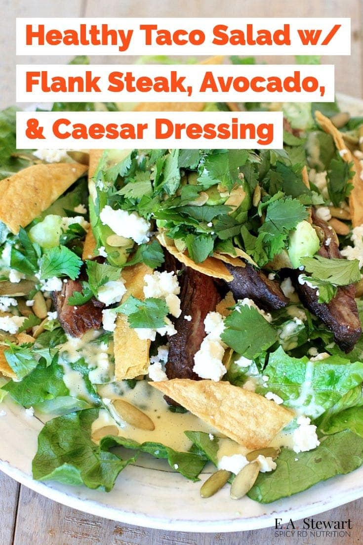 This Healthy Taco Salad with easy homemade Caesar dressing, creamy avocado, crunchy pumpkin seeds, and {optional} pan seared flank steak is delicious for dinner! Serve the toppings on the side for a family friendly (and vegetarian optional) meal everyone will love! Recipe is gluten free w/ a low FODMAP option. #tacosalad #glutenfree #salad #lowfodmap