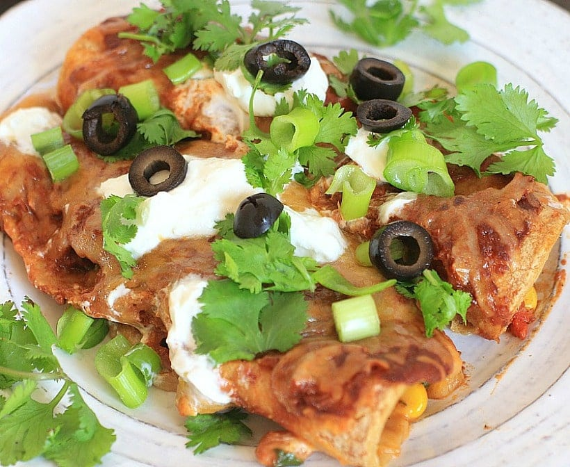 Clean out your fridge to make these Easy Vegetarian Enchiladas for dinner on busy nights! The veggies and beans are full of fiber for a healthy, gluten free meal.