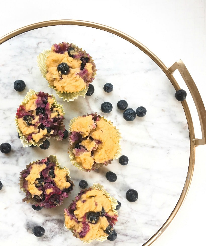 So moist, healthy, and delicious! Gluten Free Blueberry Muffins with Lemon Zest. They're paleo too, and you can make them ahead of time to microwave for a quick and easy, healthy breakfast. | Get more gluten free recipe at EA Stewart, The Spicy RD