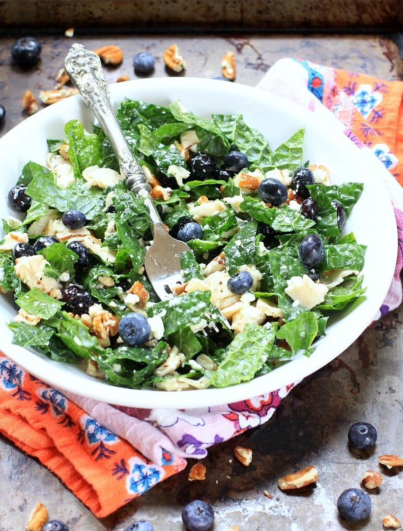 This healthy chopped superfood salad with kale, blueberries, & almonds can be tossed together in less than 10 minutes. Add your favorite protein, and you have a nourishing AND delicious lunch or dinner. | Recipe at EA Stewart, The Spicy RD @thespicyrd is gluten free & low FODMAP, with vegan, and paleo options.