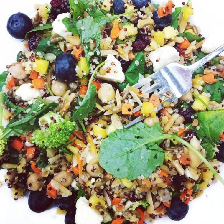 This delicious & refreshing quinoa salad {gluten free, vegan, low FODMAP option} is packed with detox friendly veggies, brain friendly blueberries, + protein & fiber rich chickpeas & almonds. Top it off with your favorite dressing, for a super nourishing plant powered salad!