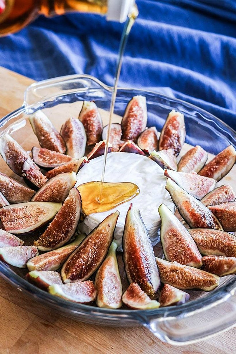 Baked Figs with Maple and Creamy Brie are the perfect match of savory cheese with sweet figs and maple syrup. Enjoy this for a healthy AND indulgent holiday appetizer!