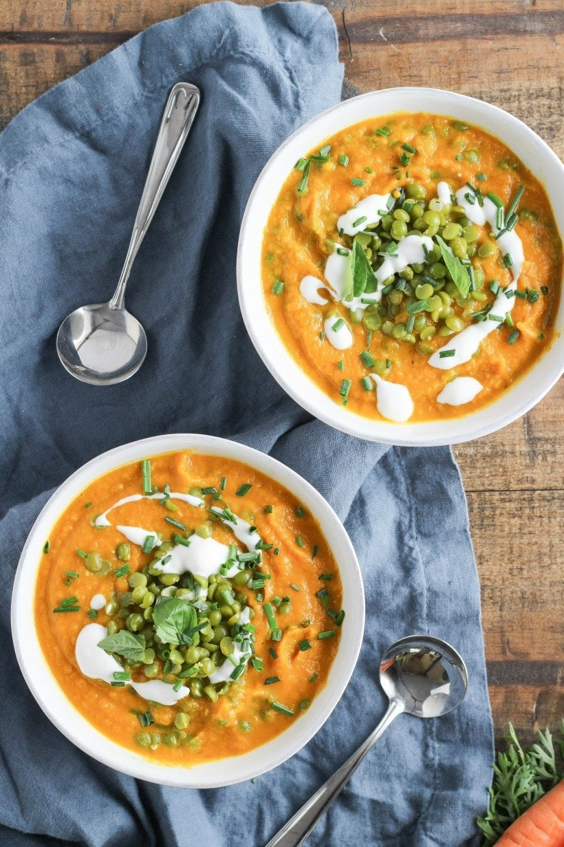 This Carrot Ginger Sweet Potato Soup is packed with seasonal fall vegetables, and it's fillinf enough to have as a main dish for lunch or dinner. Recipe by Stephanie McKercher at Grateful Grazer