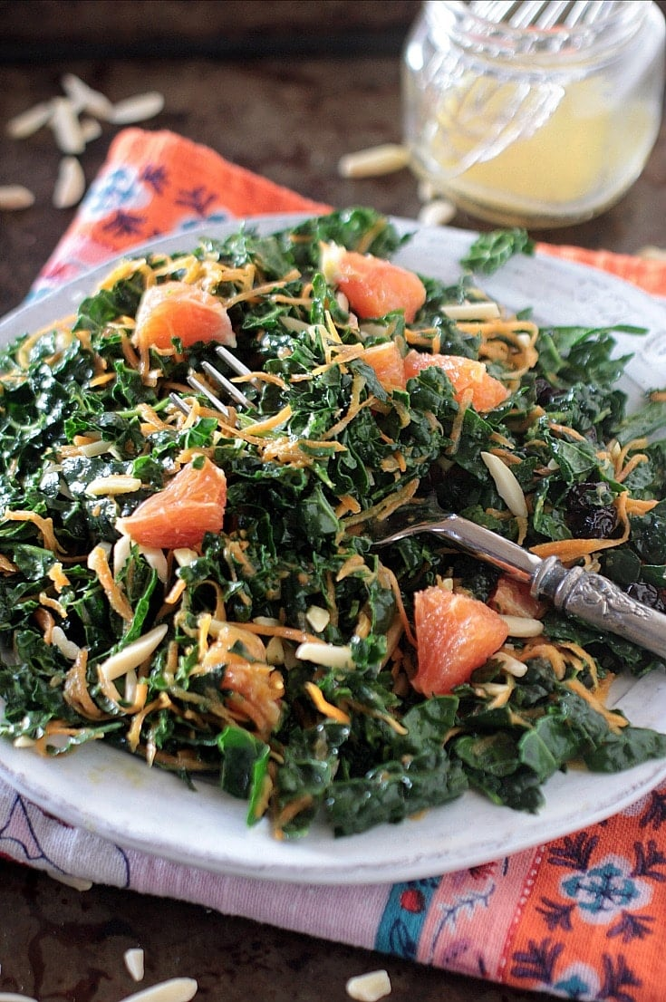 Kale Carrot Salad with Citrus Vinaigrette & Almonds | Not only is this a nourishing and delicious salad, but it also keeps for days in the refrigerator. Make a big batch on the weekend and enjoy for several lunches throughout the week! #lowfodmap #glutenfree #veganrecipes