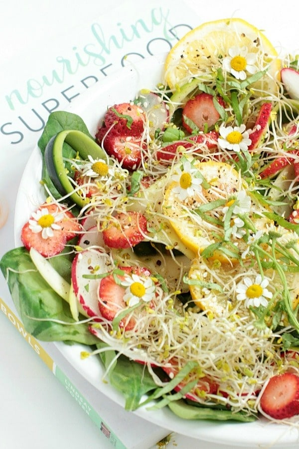 This Superfood Salad Bowl with spinach, strawberries, zucchini, radishes, and honey-miso dressing, is like summer in a bowl! It's naturally gluten-free, vegetarian, and paleo, with easy low FODMAP and vegan options. #glutenfree #superfood #salad #bowl #lowfodmap #vegan #healthyrecipes