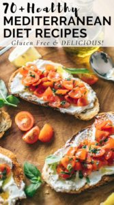 Gluten Free Mediterranean Diet Recipes featuring toast with cherry tomatoes, yogurt spread, and fresh basil on a wood cutting board.
