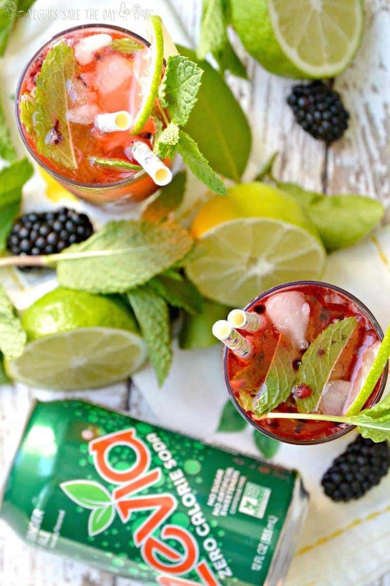 healthy mocktail recipes - 2 glasses of blackberry ginger mint mocktail with straws and a can of zevia