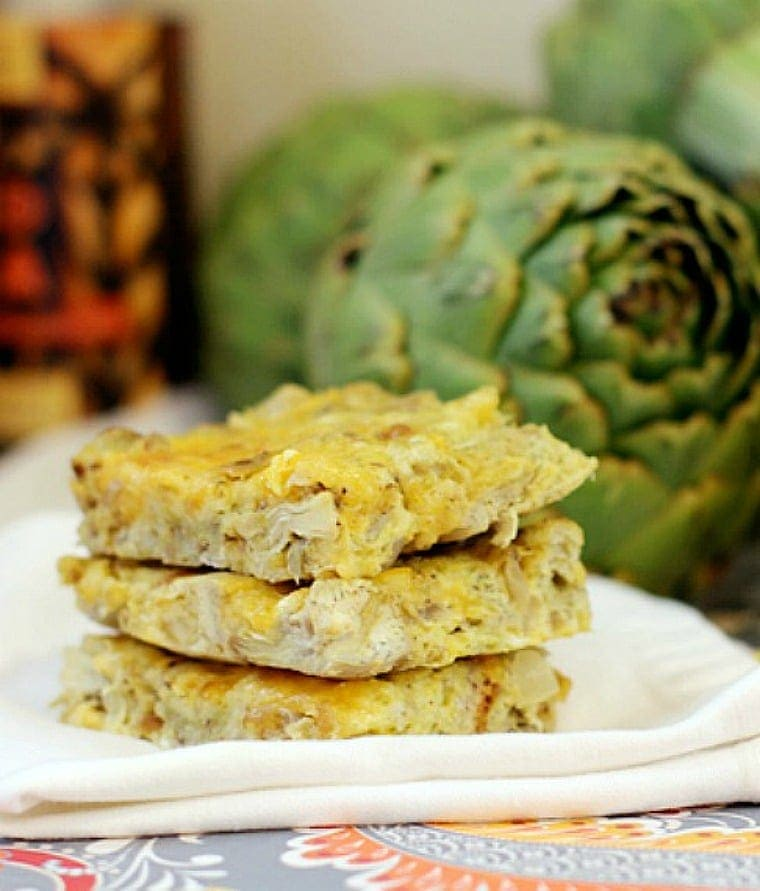Gluten Free Artichoke Squares on a white napkin.