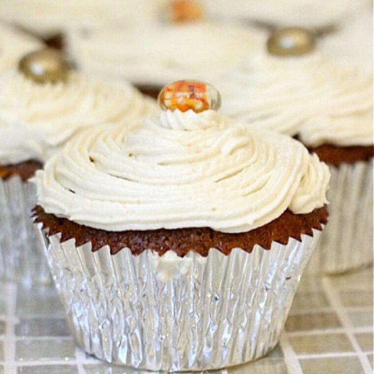 Picture of gluten free pumpkin muffins topped with buttercream frosting.