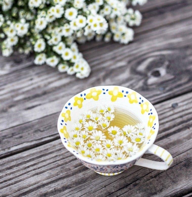 Natural Sleep Supplements including Chamomile Tea in a mug.
