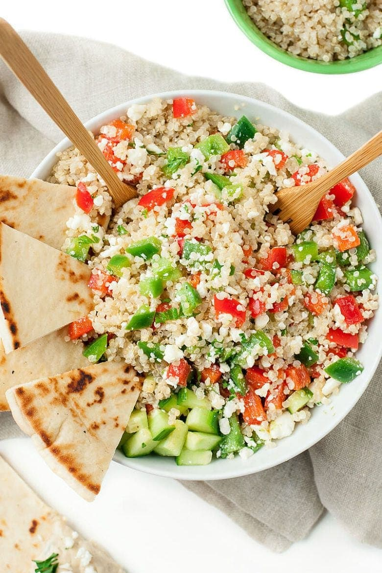 quinoa salad bowl with peppers and cucumbers