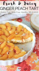 Ginger Peach Tart in a white tart pan with a floral background