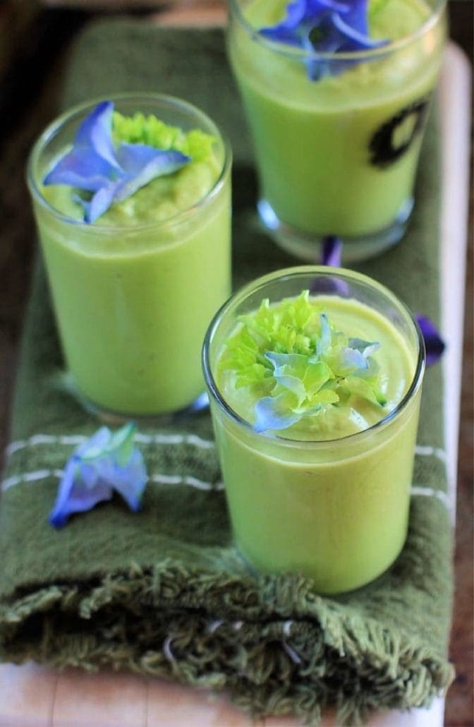 Cucumber Avocado Soup in shot glasses with hydrangeas on top