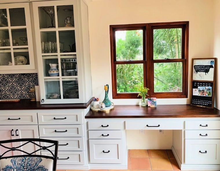 wood countertops on a desk and built in buffet in the modern farmhouse kitchen