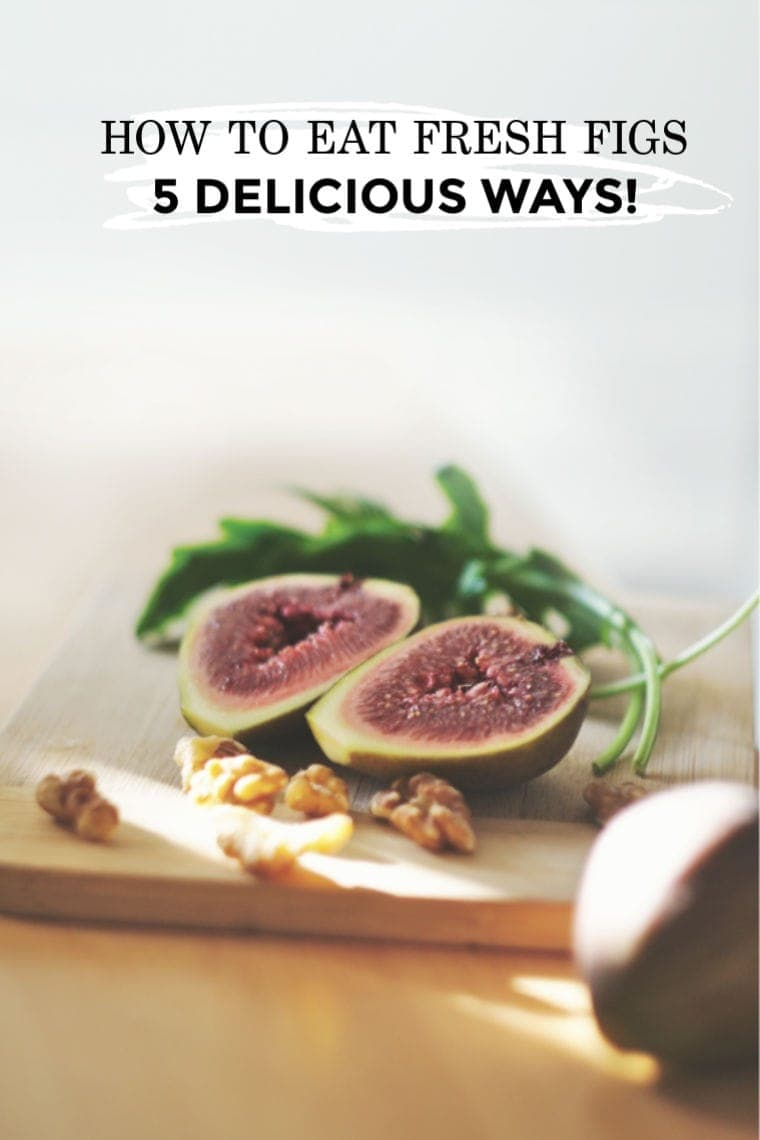how to eat fresh fig - figs on a wooden cutting board with walnuts and arugula