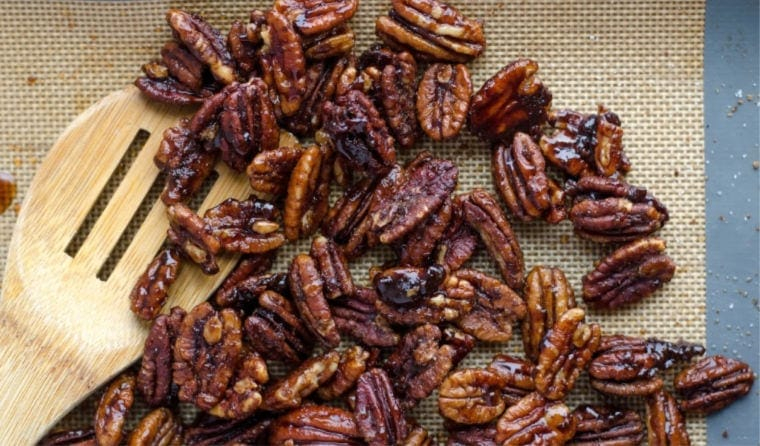 Pecan Nutrition 101 - baking sheet with candied pecans.